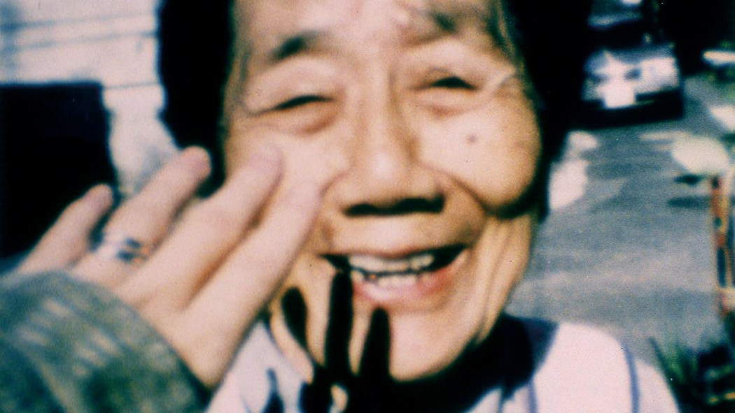 Filmmaker Naomi Kawase tries to touch her grandmother in the documentary Katatsumori