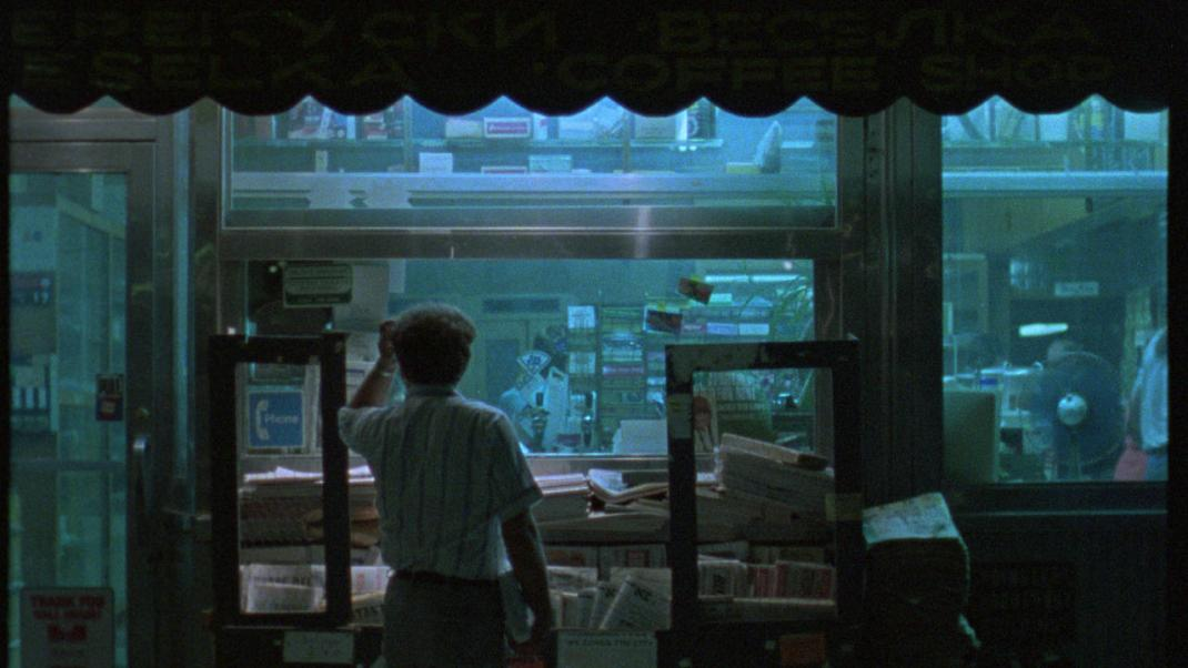 A man looks through a store display in Chantal Akerman's News From Home