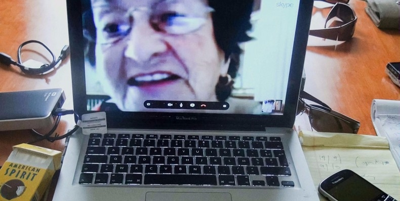 A mother appears in a video call on a laptop screen in the documentary No Home Movie